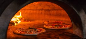 pizzaugn panorama 300x136 - Original neapolitan pizza margherita in a traditional wood oven in Naples restaurant, Italy